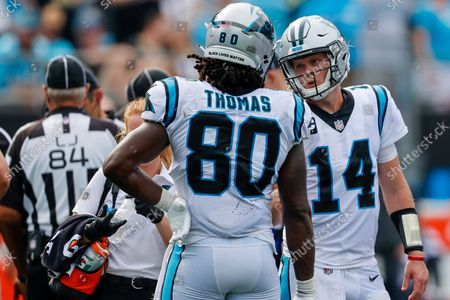 Carolina Panthers quarterback Sam Darnold, right, talks to tight end Ian Thomas during the second half of an NFL football game against the New Orleans Saints, in Charlotte, N.C