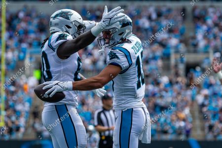 Stock Photo of Carolina Panthers tight end Ian Thomas (80) congratulates wide receiver Brandon Zylstra (16) after his touchdown against the New Orleans Saints in the first quarter of the NFL matchup at Bank of America Stadium in Charlotte, NC