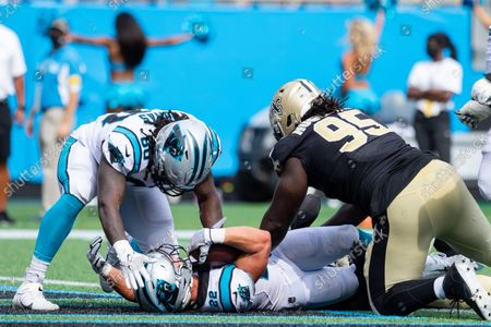 Stock Picture of Carolina Panthers tight end Ian Thomas (80) celebrates with running back Christian McCaffrey (22) after the touchdown in the fourth quarter against the New Orleans Saints in the NFL matchup at Bank of America Stadium in Charlotte, NC