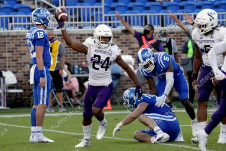 Northwestern defensive back Rod Heard II (24) celebrates a fumble recovery against Duke during the second half of an NCAA college football game in Durham, N.C