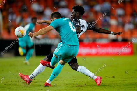 Nacho Fernandez of Real Madrid and Yunus Musah of Valencia CF