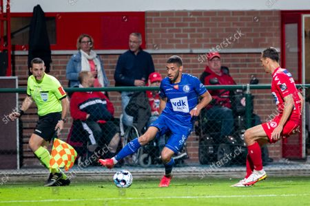Gent's Tarik Tissoudali and Kortrijk's Trent Sainsbury fight for the ball during a soccer match between KV Kortrijk and KAA Gent, Sunday 19 September 2021 in Kortrijk, on day 8 of the 2021-2022 'Jupiler Pro League' first division of the Belgian championship.