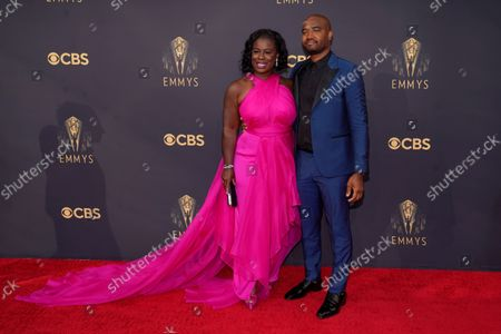 Uzo Aduba, left, and Robert Sweeting arrive at the 73rd Primetime Emmy Awards, at L.A. Live in Los Angeles