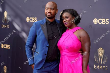 Uzo Aduba, right, and Robert Sweeting arrives at the 73rd Primetime Emmy Awards, at L.A. Live in Los Angeles