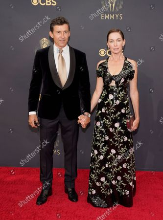 Jonathan Cake, left, and Julianne Nicholson arrive at the 73rd Primetime Emmy Awards, at L.A. Live in Los Angeles
