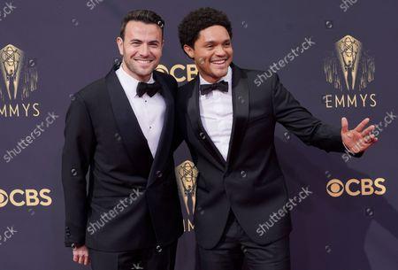 Ben Winston, left, and Trevor Noah arrive at the 73rd Primetime Emmy Awards, at L.A. Live in Los Angeles