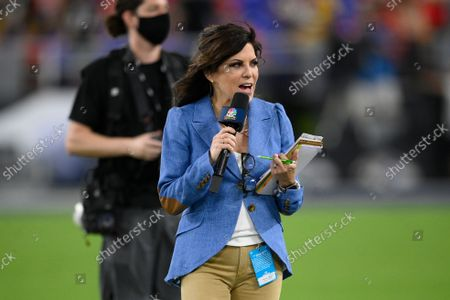 Sportscaster Michele Tafoya walks on the field before an NFL football game between the Kansas City Chiefs and the Baltimore Ravens, in Baltimore