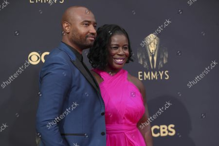 Robert Sweeting, left, and Uzo Aduba arrives at the 73rd Emmy Awards at the JW Marriott on at L.A. LIVE in Los Angeles