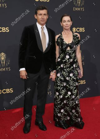 Stock Image of Jonathan Cake, left, and Julianne Nicholson arrive at the 73rd Emmy Awards at the JW Marriott on at L.A. LIVE in Los Angeles