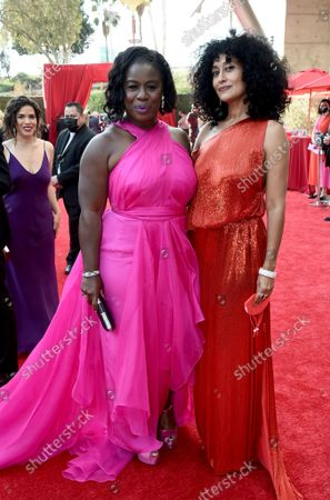 Uzo Aduba and Tracee Ellis Ross arrive at the 73rd Emmy Awards at the JW Marriott on at L.A. LIVE in Los Angeles