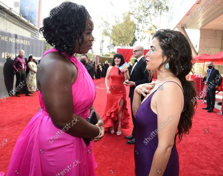 Uzo Aduba and America Ferrera arrive at the 73rd Emmy Awards at the JW Marriott on at L.A. LIVE in Los Angeles