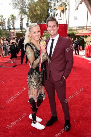 Jessica Long and Lucas Winters arrive at the 73rd Emmy Awards at the JW Marriott on at L.A. LIVE in Los Angeles