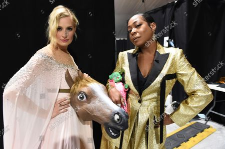 Beth Behrs, left, and Tichina Arnold appear at the 73rd Emmy Awards on at the Microsoft Theater in Los Angeles