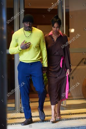 Idris Elba and wife Sabrina Dhowre Elba leave the Soho hotel after a Roland Mouret SS22 screening, street style