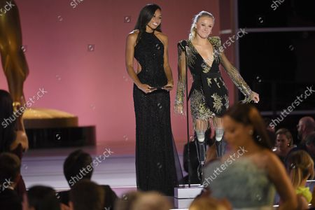 Allyson Felix, left, and Jessica Long present the award for outstanding competition program at the 73rd Emmy Awards on at the Event Deck at L.A. LIVE in Los Angeles