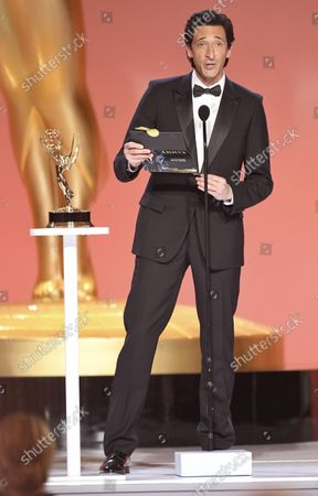 Stock Picture of Adrien Brody presents the award for outstanding drama series at the 73rd Emmy Awards on at the Event Deck at L.A. LIVE in Los Angeles