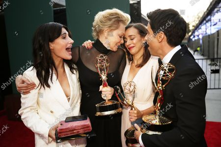 (L-R) Showrunner Jen Statsky, actress Jean Smart, showrunners Lucia Aniello and Paul W. Downs with their Emmy awards on the red carpet for the 73rd Annual Emmy Awards taking place at LA Live on/ Sunday, Sept. 19, 2021 in Los Angeles, CA. (Al Seib / Los Angeles Times)