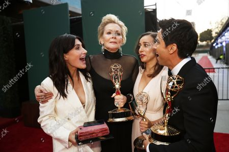 (L-R) Showrunner Jen Statsky, actress Jean Smart, co-showrunners Lucia Aniello and Paul W. Downs with their Emmy awards on the red carpet for the 73rd Annual Emmy Awards taking place at LA Live on/ Sunday, Sept. 19, 2021 in Los Angeles, CA. (Al Seib / Los Angeles Times)