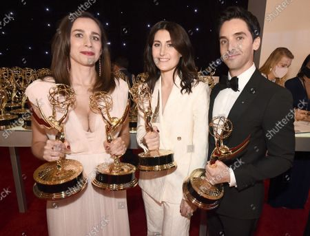"""Lucia Aniello, winner of the award for outstanding directing for a comedy series and the award for outstanding writing for a comedy series for """"Hacks"""", Jen Statsky and Paul W. Downs, winners of the winner of the award for outstanding writing for a comedy series for """"Hacks"""" pose for a photo at the 73rd Emmy Awards at the JW Marriott on at L.A. LIVE in Los Angeles"""
