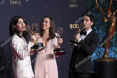 """Jen Statsky, from left, Lucia Aniello, and Paul W. Downs pose for a photo with the awards for outstanding writing for a comedy series and outstanding directing for a comedy series for """"Hacks"""" at the 73rd Emmy Awards at the JW Marriott on at L.A. LIVE in Los Angeles"""