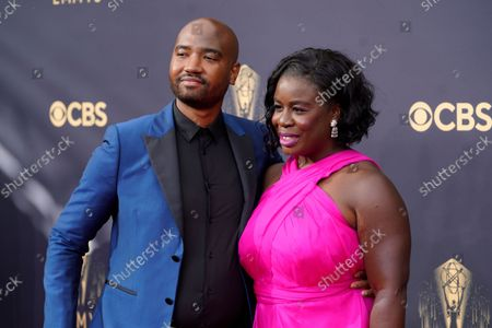Robert Sweeting, left, and Uzo Aduba arrive at the 73rd Primetime Emmy Awards, at L.A. Live in Los Angeles