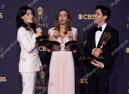 """Jen Statsky, from left, Lucia Aniello and Paul W. Downs pose with the awards for outstanding writing for a comedy series and outstanding directing for a comedy series for """"Hacks"""" at the 73rd Primetime Emmy Awards, at L.A. Live in Los Angeles"""