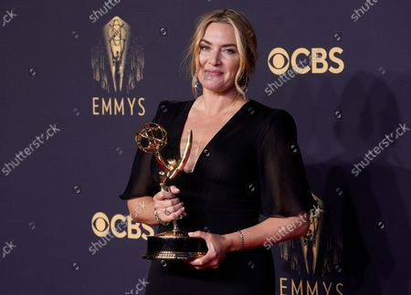 """Kate Winslet, winner of the award for outstanding lead actress in a limited or anthology series or movie for """"Mare of Easttown"""" poses at the 73rd Primetime Emmy Awards, at L.A. Live in Los Angeles"""