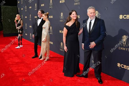 Jessica Long, from far left, Chuck Lorre, Arielle Lorre, Paula Ravets, and Paul Reiser arrive at the 73rd Emmy Awards at the JW Marriott on at L.A. LIVE in Los Angeles