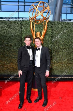 Josh O'Connor, left, and Jonathan Anderson arrive at the 73rd Emmy Awards at the JW Marriott on at L.A. LIVE in Los Angeles