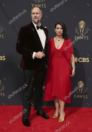 Stock Image of Craig Zobel, left, and Allison Estrin arrive at the 73rd Emmy Awards at the JW Marriott on at L.A. LIVE in Los Angeles