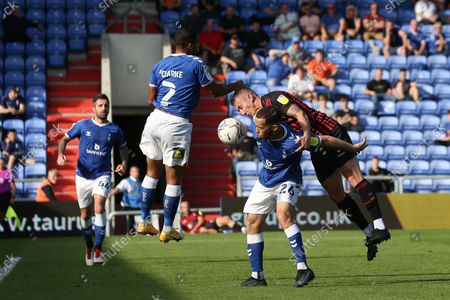 Hartlepool United's David Ferguson contests a header with Oldham Athletic's Jordan Clarke during the Sky Bet League 2 match between Oldham Athletic and Hartlepool United at Boundary Park, Oldham on Saturday 18th September 2021.
