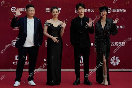 Stock Photo of From left; director Orkenbek Baysenbay, actress Bai Baihe, actor Fan Chengcheng and actress Wang Zhixuan attend the red carpet arrival for the 11th Beijing International Film Festival held on the outskirts of Beijing, China
