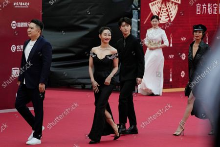 Stock Picture of From left; director Orkenbek Baysenbay, actress Bai Baihe, actor Fan Chengcheng and actress Wang Zhixuan attend the red carpet arrival for the 11th Beijing International Film Festival held on the outskirts of Beijing, China
