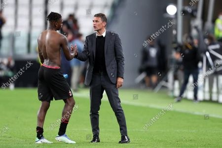 Stock Picture of Rafael Leao and Paolo Maldini of Ac Milan celebrate after winning the Serie A match between Juventus Fc and Ac Milan.