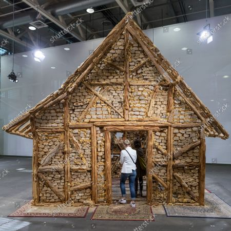 An untitled artwork (Bread House, 2004 - 2006) by Swiss-born New York-based artist Urs Fischer is on display at the show Art Unlimited in the context of the international art show Art Basel, in Basel, Switzerland, 20 September 2021. Unlimited is Art Basel's exhibition platform for projects that transcend the limitations of a classical art-show stand, including out-sized sculpture and paintings, video projections, large-scale installations, and live performances.