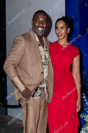 Stock Image of British actor Idris Elba (L) and his wife Sabrina Dhowre Elba (R) arrive at the British Vogue and Tiffany & Co. event to celebrate Fashion and Film at 'the Londoner' in London, Britain, 20 September 2021. Attendees gathered for the fourth annual British Vogue and Tiffany & Co. event that celebrates fashion and film.