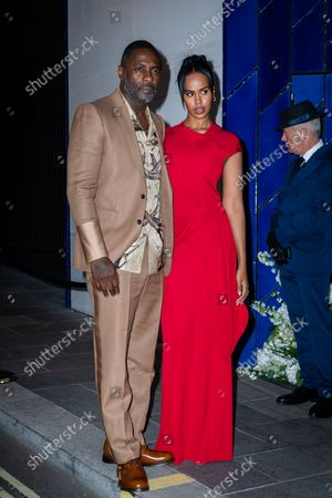 British actor Idris Elba (L) and his wife Sabrina Dhowre Elba (R) arrive at the British Vogue and Tiffany & Co. event to celebrate Fashion and Film at 'the Londoner' in London, Britain, 20 September 2021. Attendees gathered for the fourth annual British Vogue and Tiffany & Co. event that celebrates fashion and film.