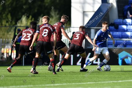 Oldham Athletic's Davis Keillor-Dunn tussles with David Ferguson of Hartlepool United during the Sky Bet League 2 match between Oldham Athletic and Hartlepool United at Boundary Park, Oldham, UK, on 18th September 2021.