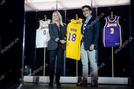 Lakers Governor Jeanie Buss (L) and Sun-Ho Lee (R), Bibigo Head of Global Business Planning, present the new 2021-2022 season Los Angeles Lakers uniform with the Bibigo logo after the announcement of a new corporate sponsorship with the company at an event at the UCLA Health Training Center in El Segundo, California, USA, 20 September 2021. Bibigo is a Korean cuisine brand.