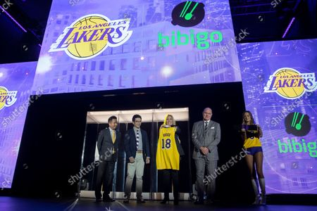 (L-R) Wookho Kyeong, CMO of CJ CheilJedang; Sun-Ho Lee, Bibigo Head of Global Business Planning; Jeanie Buss, Lakers Governor, and Tim Harris, Lakers President of Business Operations, present the new 2021-2022 season Los Angeles Lakers uniform with the Bibigo logo after the announcement of a new corporate sponsorship with the company at an event at the UCLA Health Training Center in El Segundo, California, USA, 20 September 2021. Bibigo is a Korean cuisine brand.