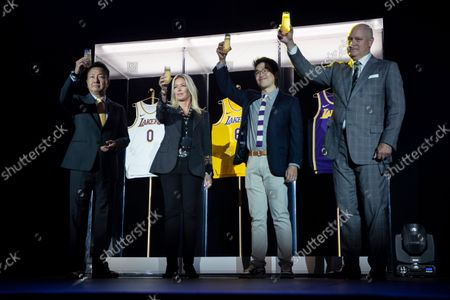 (L-R) Wookho Kyeong, CMO of CJ CheilJedang; Jeanie Buss, Lakers Governor; Sun-Ho Lee, Bibigo Head of Global Business Planning, and Tim Harris, Lakers President of Business Operations, hold up glasses of champagne as they toast to the new corporate sponsorship between the Los Angeles Lakers and Bibigo, a Korean cuisine brand, at an event at the UCLA Health Training Center in El Segundo, California, USA, 20 September 2021. The Bibigo logo will be displayed on the 2021-2022 Los Angeles Lakers' uniforms.