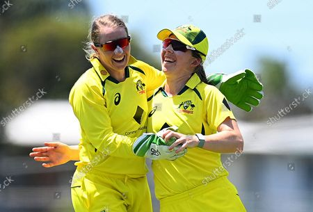 Stock Image of Alyssa Healy (L) and Georgia Wareham (R) of Australia react after the dismissal of India batsman Deepti Sharm for 9 runs on Day 1 of the Women's First One Day International (ODI) match between Australia and India at Great Barrier Reef Stadium in Mackay, Australia, 21 September 2021.