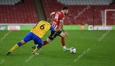 Oriol Romeu of Southampton and Oliver Burke of Sheffield United