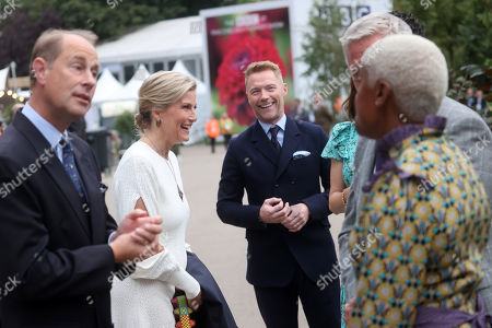 Prince Edward and Sophie Countess of Wessex speak to Ronan Keating (C) and members of The One Show team during a visit to the Autumn RHS Chelsea Flower Show