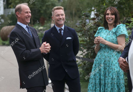 Prince Edward speaks with Ronan Keating and Alex Jones during a visit to the Autumn RHS Chelsea Flower Show