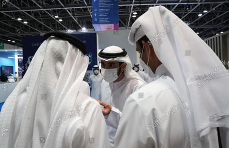 Stock Photo of Sheikh Hamdan bin Mohammed bin Rashid Al Maktoum (C), Crown Prince of Dubai and Chairman of Dubai Executive Council tours at the Gastech Exhibition and Conference in Dubai, United Arab Emirates, 21 September 2021. Around 15,000 global industry professionals are gathering at the Gastech 2021, the world's foremost exhibition and conference and energy industry, in-person for the first time after the COVID-19 pandemic.