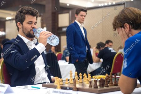 Stock Photo of Chess World Champion Magnus Carlsen (L) during the fourth round of the 36th European Club Cup in Struga, Republic of North Macedonia, 21 September 2021. Magnus Carlsen, Chess World Champion with his Norwegian team 'Offerspill Chess Club', is among the 37 Clubs from 22 European countries that take part in the 36th European Club Cup between 17-25 September 2021 in Struga, Ohrid Lake, North Macedonia.
