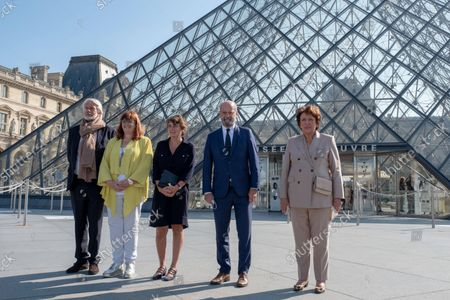 From left to right, Chris Dercon, President of the NMR - Grand Palais, Yannick Lintz, Director of the Department of Islamic Arts of the Louvre Museum and Commissioner General, Laurence des Cars, President, Director of the Louvre Museum, Jean-Michel Blanquer, Minister of National Education, Youth and Sports and Roselyne Bachelot-Narquin, Minister of Culture, pose in front of the Louvre pyramid.