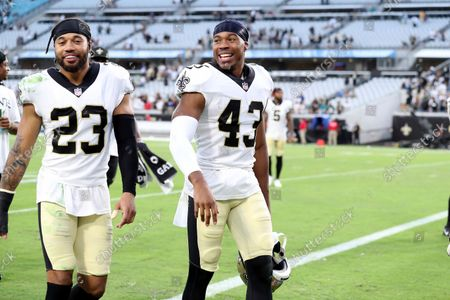 New Orleans Saints cornerback Marshon Lattimore (23) and free safety Marcus Williams (43) celebrate after an NFL football game against the Green Bay Packers, in Jacksonville