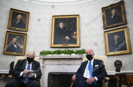 United States President Joe Biden meets with Prime Minister Boris Johnson of the United Kingdom in the Oval Office of the White House in Washington, DC on Tuesday, September 21, 2021.
